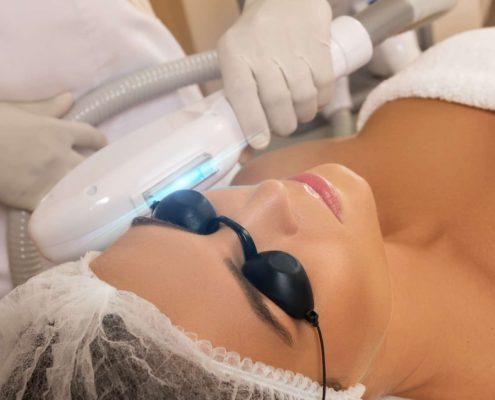 Beautiful woman in beauty salon during photo rejuvenation procedure