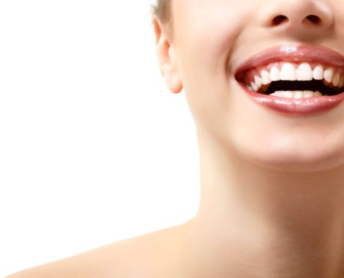 Beautiful wide smile of young fresh woman with great healthy white teeth.